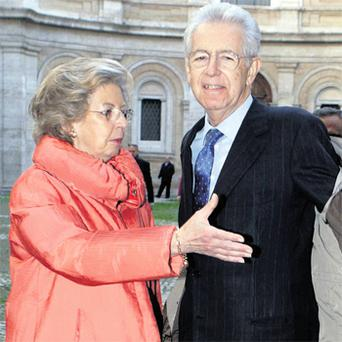 Former European Commissioner and new Italian Prime Minister Mario Monti with his wife Elsa
