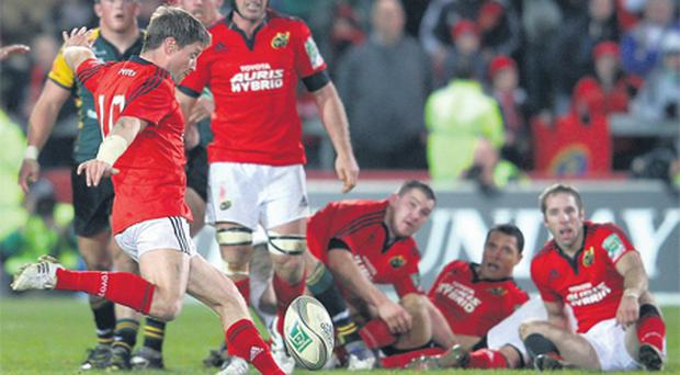 Ronan O'Gara launches the dramatic injury-time drop goal which secured Munster victory