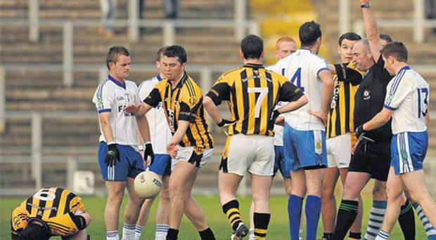 Ballinderry No 14 Martin Harney is shown the red card by referee Martin Sludden at Casement Park yesterday
