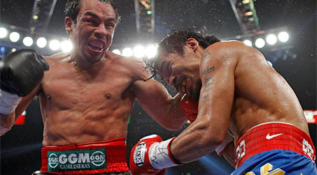 Juan Manuel Marquez, left, in action against Manny Pacquiao