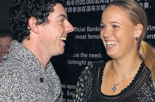 Happy couple: Rory McIlroy and Caroline Wozniacki at a party for the WGC-HSBC Champions in Shanghai earlier this week