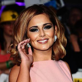 Cheryl Cole could miss a duet with Gary Barlow due to illness