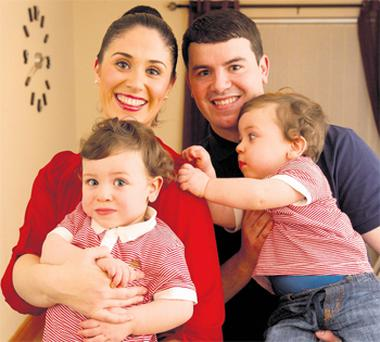 Aisling Byrne and Keith Corbally with their 17-month-old twin sons Sam and Ben at home in Ayrfield Court, Dublin