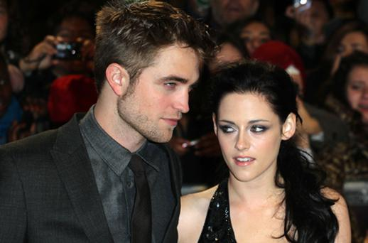 Robert Pattison and Kristen Stewart attend the UK premiere of The Twilight Saga: Breaking Dawn Part 1 at Westfield Stratford City in London. Photo: Getty Images
