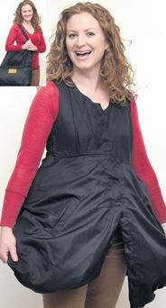 From bag to dress: Tina demonstrates the two uses of the JakToGo dress, 'wearing' two weeks of clothes inside it