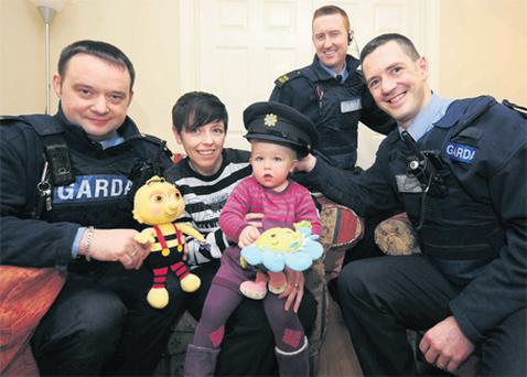 Sharon Gahan from Mullingar with her daughter Maddie (2) and the gardai – from left, Vincent Frayne, Brian Craven and Vincent Reynolds – who helped save Maddie from a house fire in August