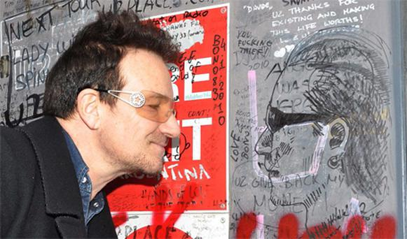 Bono checks out U2 fans' graffiti at their Hanover Quay studio in Dublin yesterday