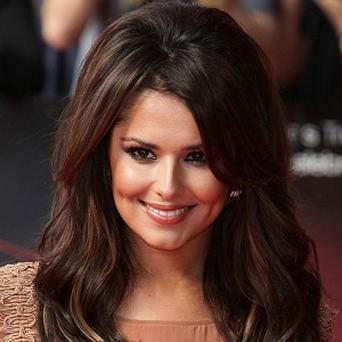 Cheryl Cole was said to be 'gutted' at missing a Children In Need show
