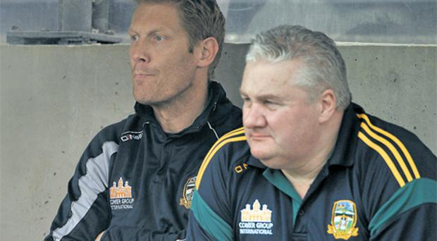 Graham Geraghty and Paul Grimley sit on the Meath bench last season, but they won't be teaming up again after Grimley's return to Armagh