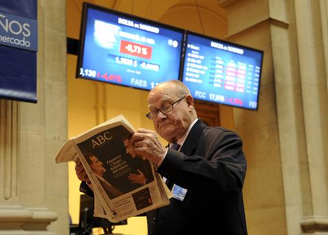 A man reads the newspaper at Madrid's Stock Exchange. Photo: Getty Images