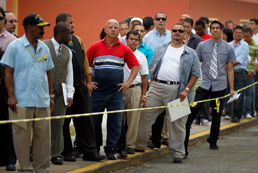 Job seekers line up to apply for an opening with Major League Baseball's Miami Marlins earlier this week. Photo: Getty Images