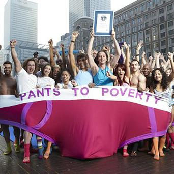 Fifty-seven Pants to Poverty supporters fitted into a giant pair of pants in London to set a new world record