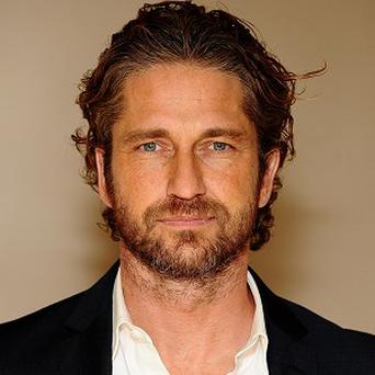 Gerard Butler is being lined up to take the role of Army officer-turned-mercenary Simon Mann
