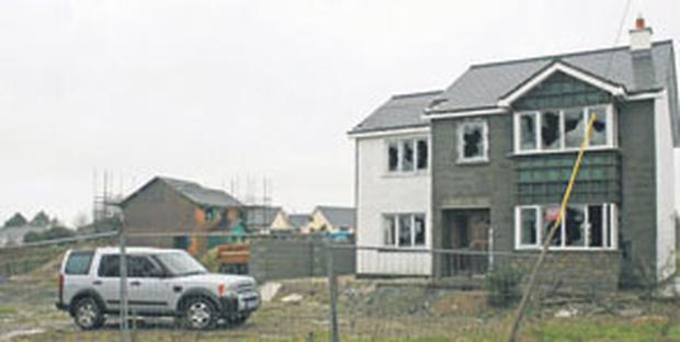 One of the houses at various stages of destruction as it is razed to the ground at Church View in Clongeen, Co Wexford
