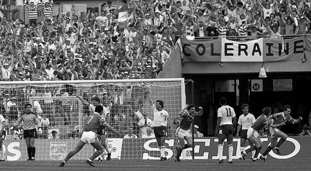 Ray Houghton celebrates his goal against England at Euro '88 with team-mates Ronnie Whelan, as John Aldridge and Paul McGrath run to join the celebrations at the Neckarstadion in Stuttgart.