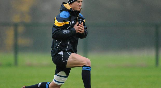Leinster's Jonathan Sexton limbers up at training ahead of tomorrow's Heineken Cup encounter with Glasgow at the RDS