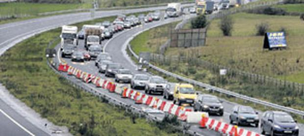 GOING NORTH: The long tailback of southern registered cars driving across the Border into Newry to take advantage of the bargains. Photo: Steve Humphreys