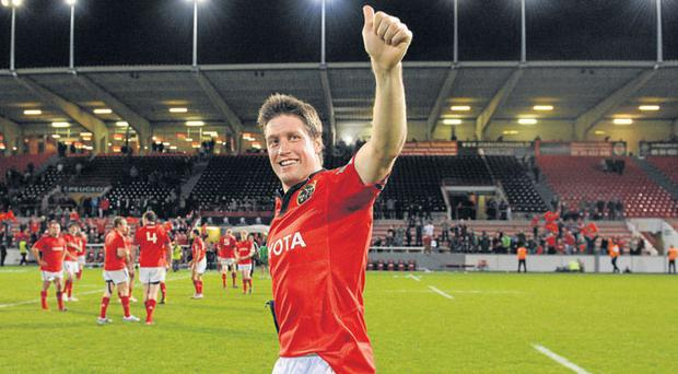 Ronan O'Gara acknowledges Munster supporters at the Stade Ernest Wallon in Toulouse after his last minute drop goal earned his side a dramatic victory over Castres yesterday. Photo: Diarmuid Greene