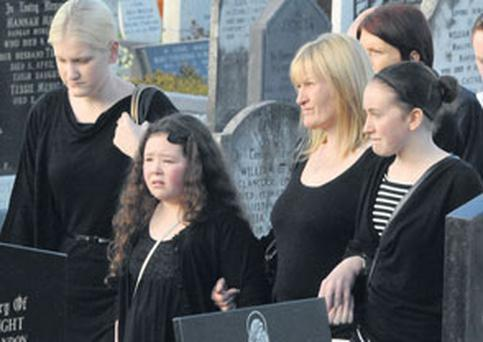 HEARTBREAK: At the funeral of Jonathan Duke at St Patrick's Church, Bandon, Co Cork, was the deceased's mother Michelle and his daughter Angel. Photo: Denis Boyle