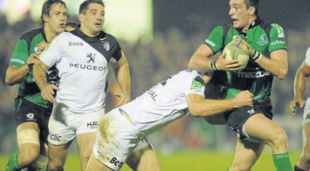 Connacht's Brian Tuohy is tackled by Yannick Jauzion of Toulouse during last night's Heineken Cup game at the Sportsground. Photo: Ray Ryan