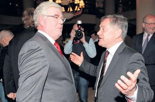 BROTHERS IN ARMS: Labour Party leader and Tanaiste Eamon Gilmore with Public Expenditure Minister Brendan Howlin before the start of the Labour Party's Special Parliamentary Party meeting in Tullow, Co Carlow. Photo: Frank McGrath