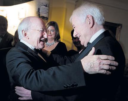 WARM EMBRACE: President Michael D Higgins greets poet and Nobel laureate Seamus Heaney with obvious delight at the Irish Book Awards