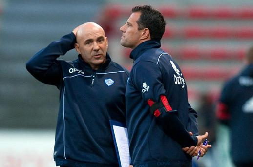 Castres coaches Laurent Labit (R) and Laurent Travers (L) speak together during the European Cup rugby union match Castres vs Munster