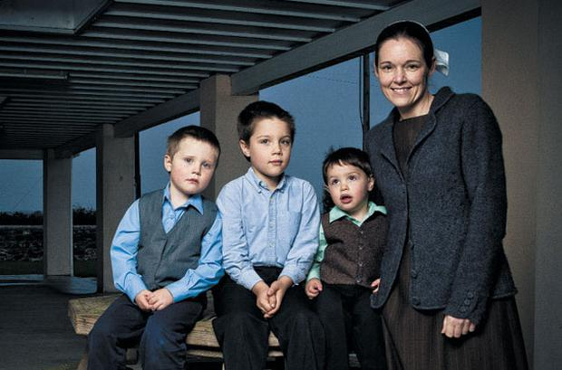 'We would feel that the man of the house is supposed to be the provider' — Naomi Byler, 37, with three of her four nephews, Judah, 3, Niall, 6, and Levi, 2