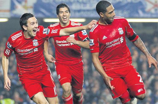 Glen Johnson celebrates his winning goal at Stamford Bridge yesterday alongside team-mates Stewart Downing and Luis Suarez