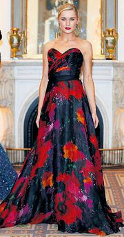 Hand-painted silk floral full-length gown, €1,100, Don O'Neill for Theia; gold 'baroque n' roll' earrings, €529, Erickson Beamon