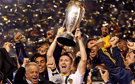 Robbie Keane lifts the MLS Cup
