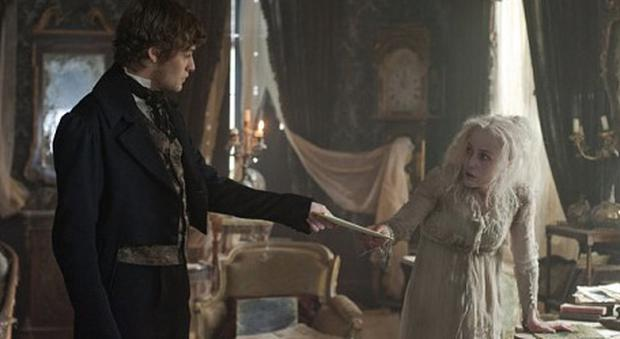 Douglas Booth as Pip and Gillian Anderson as Miss Havisham in Great Expectations