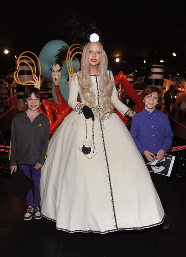 NEW YORK, NY - NOVEMBER 21: Lady Gaga poses with young fans in Gaga's Workshop at Barneys New York on November 21, 2011 in New York City. (Photo by Jamie McCarthy/Getty Images for Barneys New York)