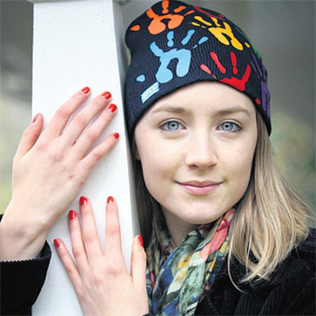 Saoirse Ronan modelling an Elvery's ISPCC beanie hat yesterday