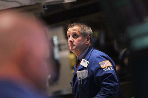 A trader works on the floor of the New York Stock Exchange on November 21. Photo: Getty Images