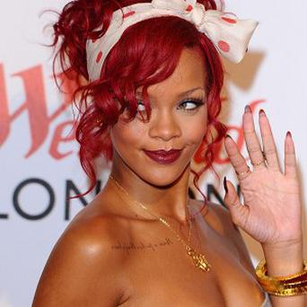 Rihanna's reign at the top of the UK singles chart kept Flo Rida in second place