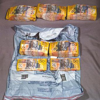 A man has reportedly left a suitcase containing one million Australian dollars at a Sydney restaurant