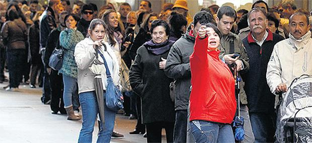 People queue up to buy 'El Gordo' (The Fat One) Christmas lottery tickets in downtown Madrid yesterday