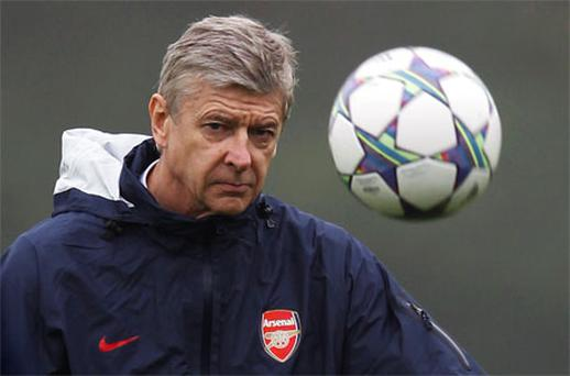 Arsenal manager Arsene Wenger kicks a ball during a team training session in London Colney November 22. Photo: PA