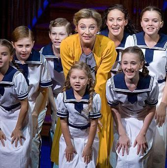 Wietske van Tongeren, centre, performs with children during a dress rehearsal for the musical The Sound of Music (AP)