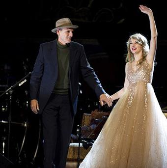 James Taylor and Taylor Swift on stage at New York's Madison Square Garden
