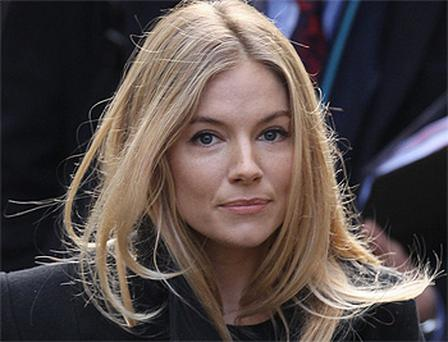 Sienna Miller arrives to give evidence to The Leveson Inquiry at The Royal Courts of Justice in London