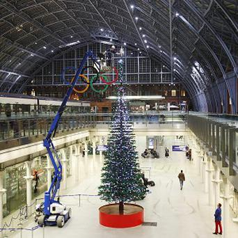 A Lego Christmas tree is erected at St Pancras International