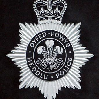 Dyfed-Powys Police halted a funeral in Begelly after police suspected the deceased man was a fugitive