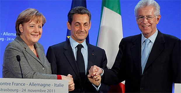 German Chancellor Angela Merkel (left), French President Nicolas Sarkozy (centre) and Italian Prime Minister Mario Monti hold hands at the end of a news conference after a trilateral meeting on eurozone crisis in Strasbourg