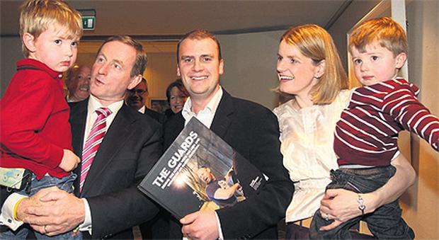 Taoiseach Enda Kenny with photojournalist Mark Condren (centre) and his wife Michelle and sons Ben and Aaron at the launch of his book 'The Guards', at AIB HQ in Ballsbridge, Dublin