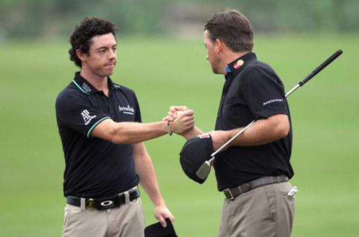 Rory McIlroy and Graeme McDowell celebrate on the 18th green. Photo: Getty Images