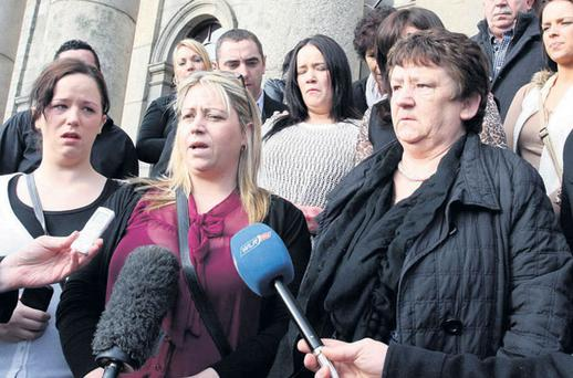 Belinda Murphy (second from left), sister of victim Patrick Murphy, outside court with her mother Margaret (right).