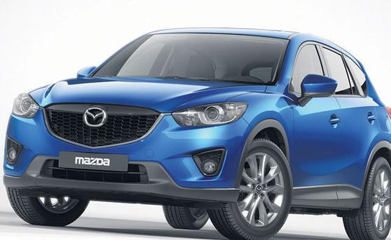 NEW LOOK: The Mazda CX-5 SUV has a strong grille, sculpted sides and raked rear window