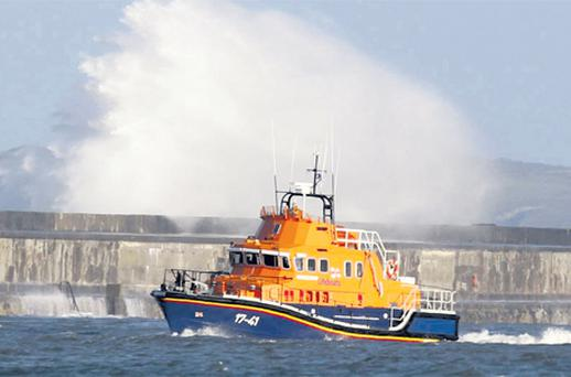 A lifeboat leaves Holyhead in Wales yesterday to search for five missing Russian sailors whose ship sank in heavy seas